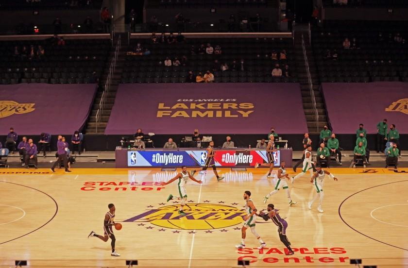 The Lakers and Celtics begin their game on April 15, 2021, with some fans in the stands at Staples Center.